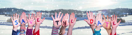 Children Hands Building Word Save The Date, Snowy Winter Background