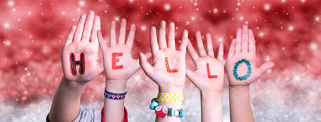 Children Hands Building Word Hello, Red Christmas Background