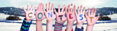 Children Hands Building Word Contest, Snowy Winter Background