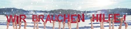 Hands Holding Word Wir Brauchen Hilfe Means We Need Help, Winter Background
