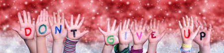 Children Hands Building Word Do Not Give Up, Red Christmas Background