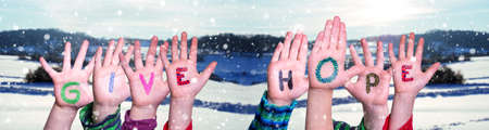 Children Hands Building Word Give Hope, Snowy Winter Background