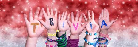 Children Hands Building Word Trivia, Red Christmas Background Zdjęcie Seryjne