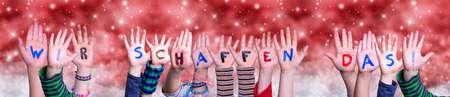 Children Hands Wir Schaffst Das Means We Can Do It, Red Christmas Background Zdjęcie Seryjne