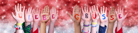 Children Hands Liebe Gruesse Means Greetings, Red Christmas Background