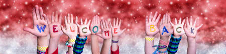 Children Hands Building Word Welcome Back, Red Christmas Background