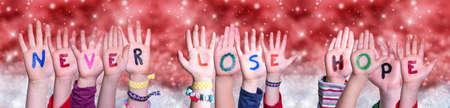 Children Hands Building Word Never Lose Hope, Red Christmas Background 版權商用圖片