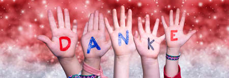 Children Hands Danke Means Thank You, Red Christmas Background
