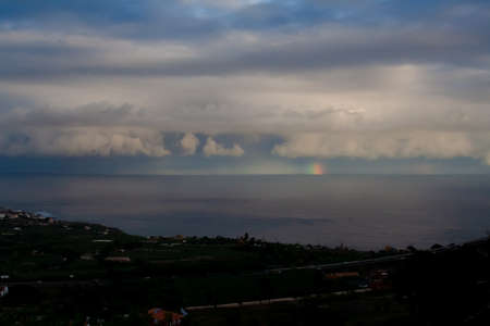 Spectacular far view over the sea with rainbow