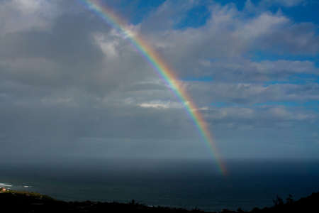 beautiful rainbow over the atlantic with clouds Stock Photo