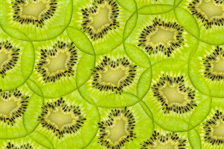 fresh juicy kiwi fruit. green background photo