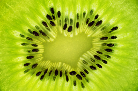 healthy cooking: fresh juicy kiwi fruit. green background Stock Photo