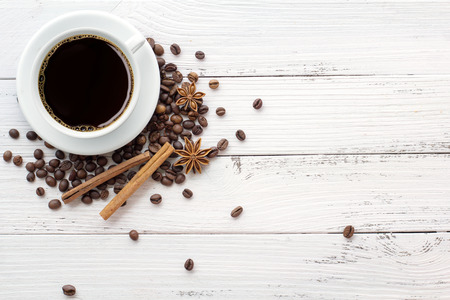coffee and spices on white wooden vintage background photo