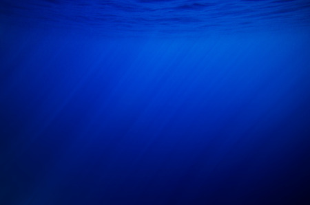 beneath the surface: Abstract underwater deep blue backgrounds