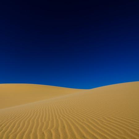 sand desert and blue sky background Standard-Bild