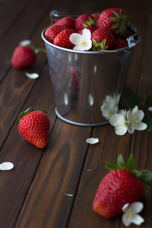 strawberry on dark wooden table photo