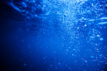 underwater background, deep blue sea with sunrays Stockfoto