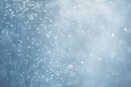 falling snow, abstract blue bokeh background