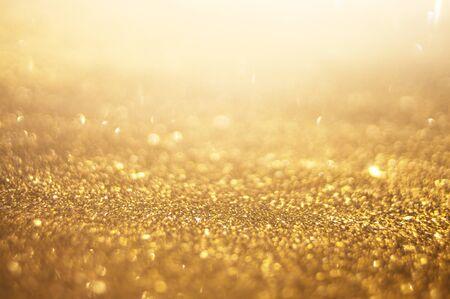 scintillio dorato, sfondo bokeh astratto
