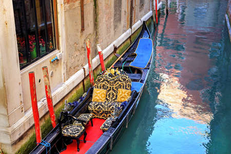 Luxury Gondola waiting for tourists near Rialto Bridge in Venice