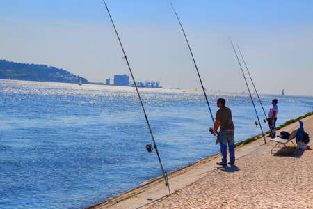 LISBON, PORTUGAL-OCTOBER 17, 2017: People fishing and enjoying the weekend near Land