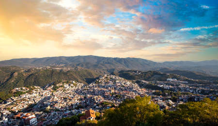 Mexico, Taxco city lookout overlooking scenic hills and colorful colonial historic city center.