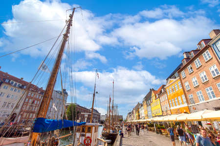 Copenhagen, Denmark-2 August, 2020: Famous Nyhavn, New Harbour, bay in Copenhagen, a historic European waterfront with colorful buildings. A starting point for boat and canal tours.