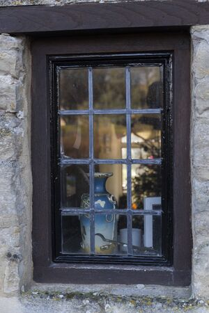 window with wooden frame on stone facade