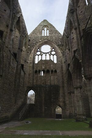 ancient ruined stone abbey, very well preserved, has no roof and you can see the sky