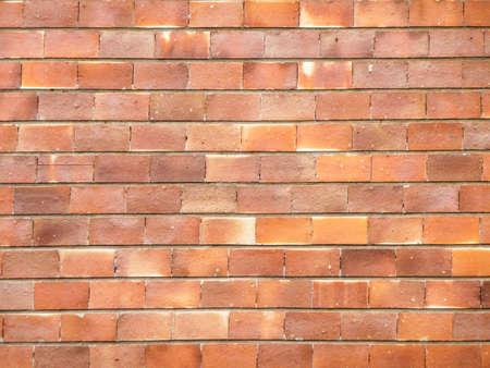 Brick wall of orange stone photo