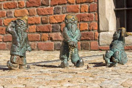dwarfs: Three dwarfs symbol Wroclaw in Poland acting as the three wise monkey, deaf blind and mute