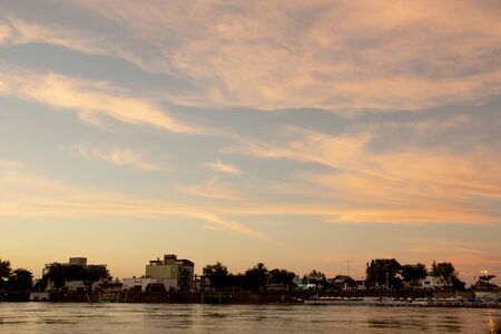 Between R? Os Argentina February 22, 2016: city on the bank of the Gualeguaych? River in a semi-clear summer sunset Sajtókép