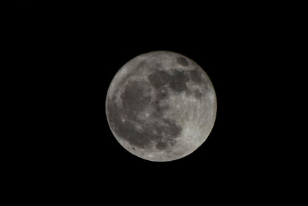 Full moon on black background. Stock fotó