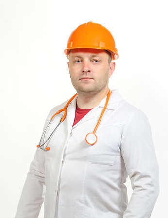 A man in a white coat, helmet and phonendoscope. Stock Photo