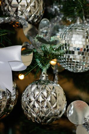 silver and white Christmas and New Year tree decorations