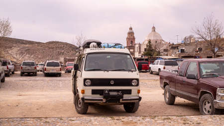 Real de Catorce, Mexico, December 22nd, 2017: tourist parking lot in town with cars parked and the church tower Redactioneel