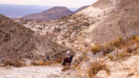 Horse rider going down the hill at Real de Catorce