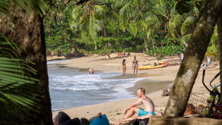 Arrecife Beach, Costa Rica - August, 27th, 2018: tropical beach landscape with people during a sunny day Archivio Fotografico - 134756915