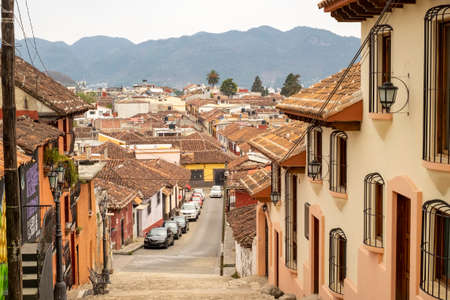 San Cristobal de las Casas, Chiapas, Mexico - March 7th, 2018: streets of the colonial town with roofs and cars parked Redactioneel