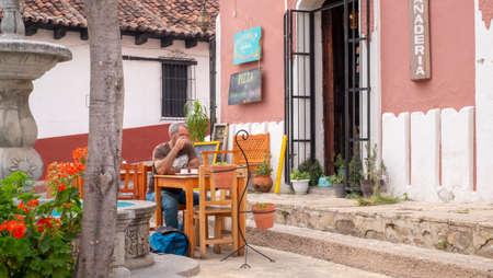 San Cristobal de las Casas, Chiapas, Mexico - April 24th, 2018: coffee terrace with tourist sit