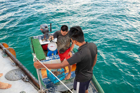San Blas Archipelago, Panama - November 22nd, 2018: Locals with small boat selling lobster to tourist