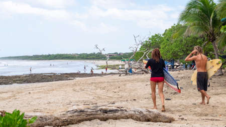 Playa Avellana, Costa Rica - July 7th, 2018: beach landscape with people and surfers