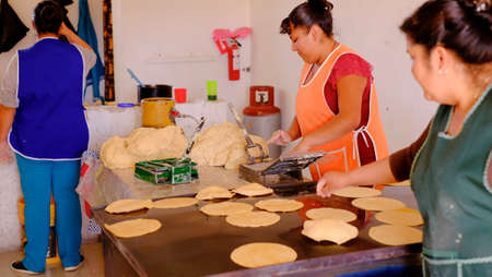 Aculco, mexico - January, 11th, 2018: handmade mexican tortillas, aka tacos, by a group of local women