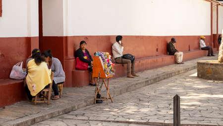 San Cristobal de las Casas, Chiapas, Mexico - March 13rd, 2018: local people sit at the square Editorial