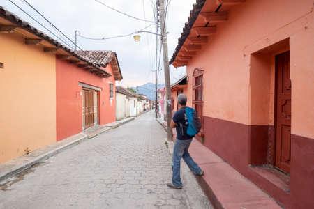 San Cristobal de las Casas, Chiapas, Mexico - March 7th, 2018: one person walking on street of the colonial town Editorial
