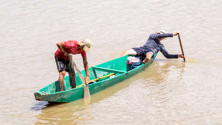 Magdalena river, Cambao, Colombia, January, 27th, 2019: artisan fishermen at daily task