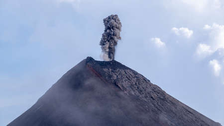 Fire volcano in Guatemala erupts with lava and smoke  Stock Photo