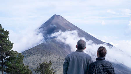 Couple looking at Fire volcano in Guatemala Stock Photo