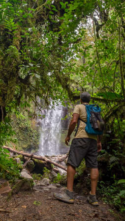 Hiker looking at one of the 3 Lost waterfalls trail in Boquete, Panama
