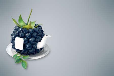 steam of a leaf: Blackberry tea cup. Healthy food. Blackberry drink